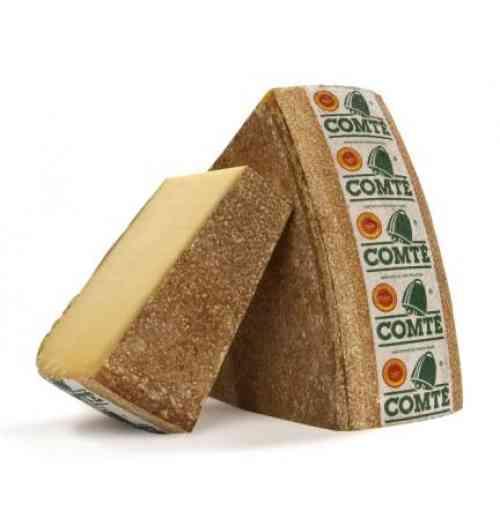 """LE COMTE  1er AOP fromagère de France - Le Comté vous invite à savourer le temps !  Le Comté est un fromage au lait cru à pâte pressée cuite. Son terroir est le Massif du Jura, une région de moyenne montagne qui s'étend sur le Jura, le Doubs (deux départements de la région Bourgogne-Franche-Comté) et l'Ain (département de la région Auvergne-Rhône-Alpes). Les vaches de races Montbéliarde et Simmental française sont les seules autorisées pour la production du lait à Comté.  Chaque jour, le Comté est élaboré artisanalement dans environ 150 petites fromageries de village, les """"fruitières"""". Pour prendre son goût, le Comté prend tout son temps. Sa maturation en cave d'affinage est au minimum de 4 mois, mais elle est souvent supérieure. Le Comté se caractérise par son étonnante richesse aromatique. Ce n'est pas un fromage à goût uniforme. Chaque meule de Comté révèle un profil aromatique différent selon sa micro-région d'origine, sa saison, selon le tour de main particulier du maître fromager, selon la cave où elle a été élevée. En cela, le Comté est un fromage UNIQUE. Particulièrement riche en protéines, calcium, phosphore, cuivre, zinc, vitamine A et B12 et source de vitamine B2, le Comté est un aliment précieux, dont les apports sont très utiles à l'équilibre alimentaire. Élaboré sans aucun additif ni colorant, contrôlé à chaque étape de sa fabrication, le Comté est un aliment SAIN ET NATUREL."""