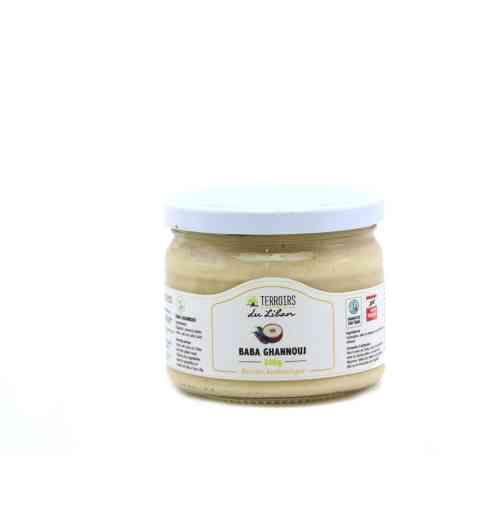 Baba ghanouj - 300g - Tartinade à l'aubergine et  tahiné (crème de sésame). Servir avec de l'huile d'olive et du pain. Se marie bien avec les grillades et les légumes. Idéal pour étaler sur les toasts et pita ou en trempette pour l'apéritif.