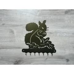 accroche-clefs - <p>accroche-clefs métal.</p> <p>Peinture bronze martelé.</p> <p>dimension: 26cm en horizontal</p> <p>plusieurs centaines de dessins disponibles</p>