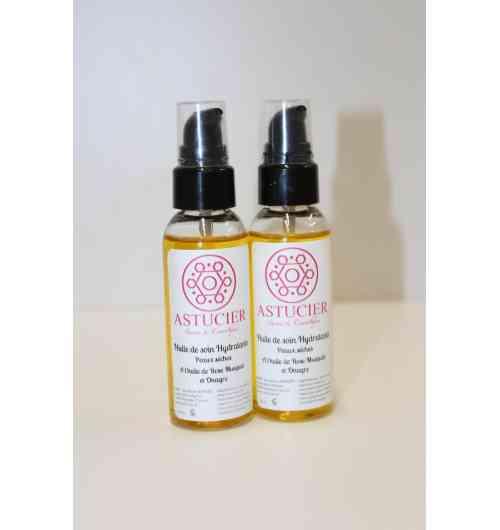 Huile de soin hydratante - L'huile de soin Hydratante aide à lutter contre l'inconfort des peaux très sèches en leur apportant souplesse et hydratation.  L'association de l'huile d'onagre et de rose musquée, non grasse, pénètre merveilleusement, pour laisser un teint frais lisse et soyeux.   100% naturelle, de formulation simple : huile de rose musqué*, huile d'onagre*, huile de sésame*, tocophérol (antioxydant naturel)  Utilisée chaque jour, elle laissera votre peau : désaltéré, confortable et sans tiraillement.  L'huile de rose musqué riche en acide gras linoléique est reconnue pour ses vertus régénérantes cutanées  et anti-âge.  Elle aide à nourrir les peaux abîmes et favorise la cicatrisation. L'huile d'onagre gorgé de vitamine E et d'acide gamma-linoléique assure la protection et l'hydratation de votre peau.  ingrédients : Sesamum Indicum Seed Oil, Camelina Sativa Seed Oil, Oenothera Biennis Oil, Rosa Canina Fruit Oil, Helianthus Annuus Seed Oil, Tocopherol